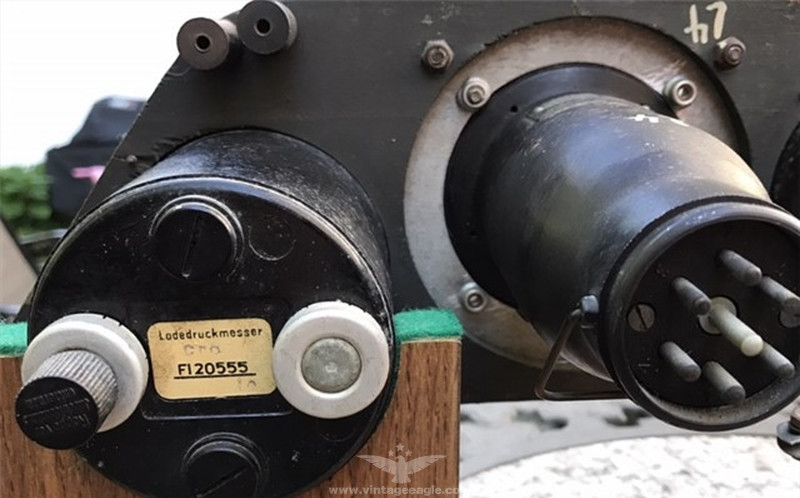 it had a manifold pressure gauge with an extended range to 2 0 ata and a  different type of horizon (fl 22411),